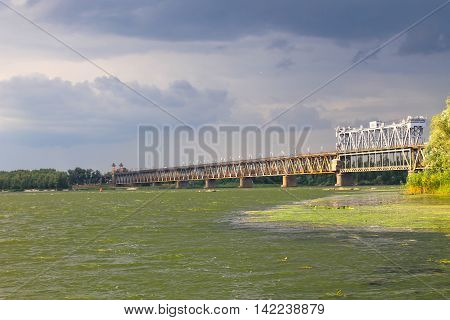 Bridge across river Dnieper in Kremenchug and storm clouds in sky