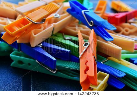 background clothespins of various colors and piled up