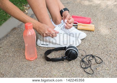 Female Runner Trying Running Shoes Getting Ready For Jogging