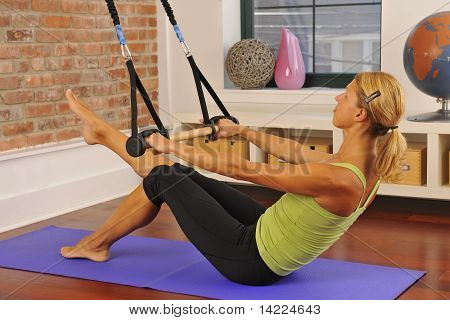 Blond Exercising Pilates Bar