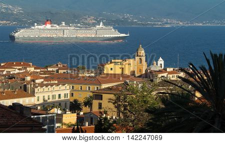 The houses of Ajaccio city the capital of South Corsica island and giant cruise ship in the background.
