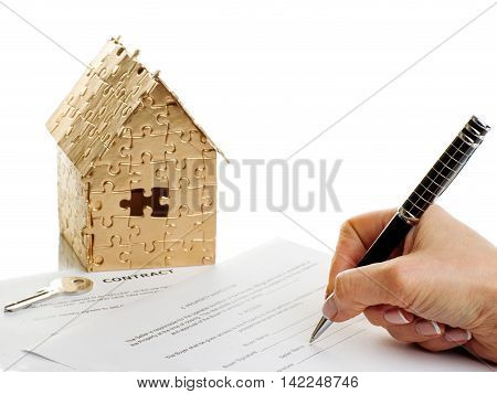 house of gold color with a stopwatch and a contract isolated on white background. Concept: time to buy a house