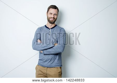 A Portrait of a men in studio gray background