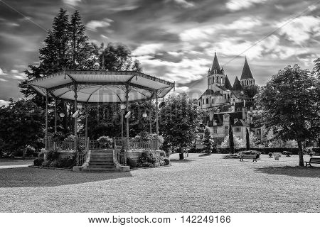 Collegiate Church Saint-Ours Loches of Loches (France). Founded between 963 and 985. View from city park with bandstand
