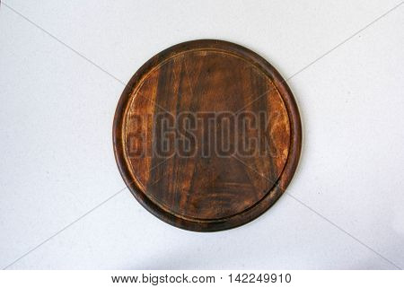 Background: big round cutting board on light textured table