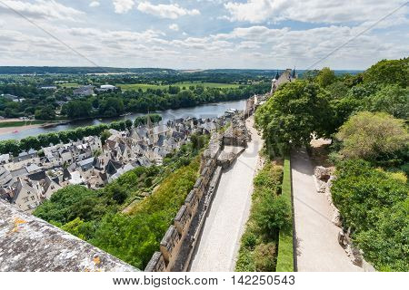 Chinon walled castle. Chinon is a commune located in the Indre-et-Loire department in the Region Centre. The Loire Valley with its castles is UNESCO World Heritage Site France