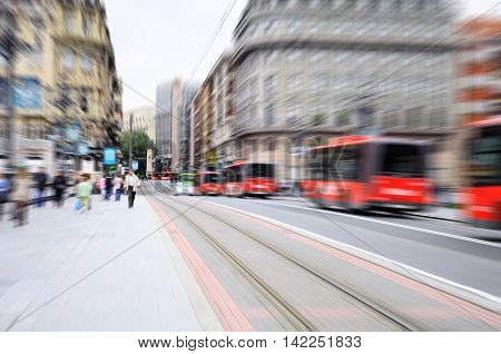 Blurred image of the streets of Bilbao at evening time. Spain.