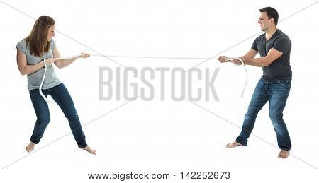 A couple on studio white background pull the rope