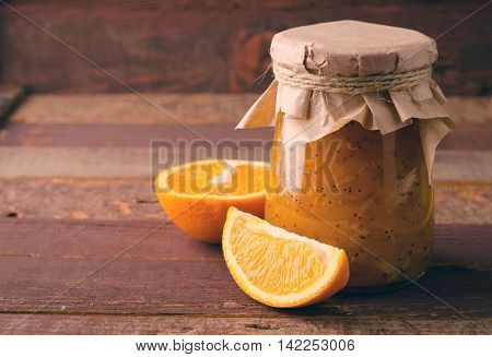 Pumpkin-Orange-Ginger-Poppy seed jam on wooden background, copy space