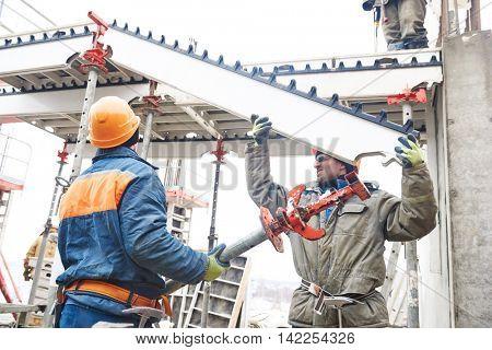 worker installing falsework construction