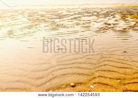 Tropical beach in ebb time on sunset background Koh Chang Thailand. Standing water on the beach at low tide.