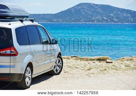 travelling. Automobile minivan view near sea beach