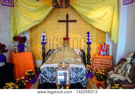CUERNAVACA / MEXICO - OCTOBER 31 2013: Day of the Dead Altar shown in the Brady Museum of Cuernavaca for the festivities season.