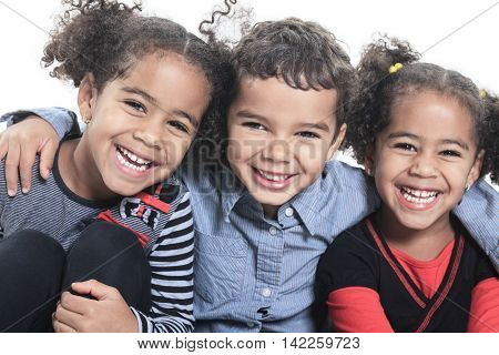 A cute african american on white background. Two twin with the brother.