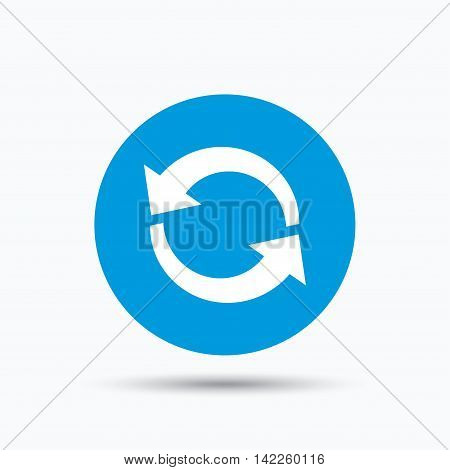 Update icon. Refresh or repeat symbol. Blue circle button with flat web icon. Vector