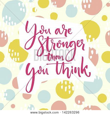 You are stronger than you think. Motivation quote lettering on playful green and pink hand drawn circles background.