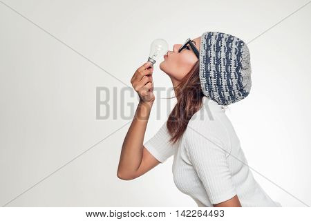 Picture of asian woman kissing lamp,Happy mood