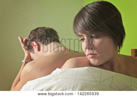 A Young couple who having hard time in bed.
