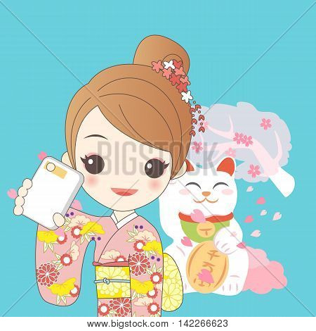 japanese girl is selfie and wear kimono with cherry blossom or sakura and Japanese lucky cat MANEKI NEKO