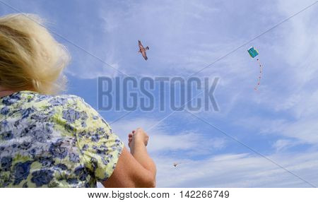 People fly kites on the beach in Seaton England