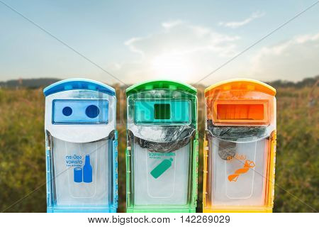 Recycling bins on the background blurred sky background ecology concept.