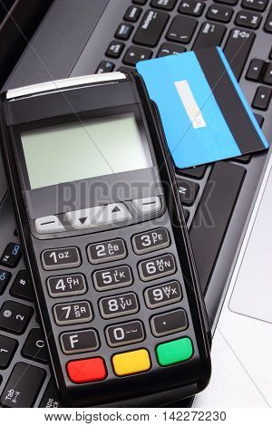 Payment Terminal And Credit Card On Laptop Keyboard, Finance Concept