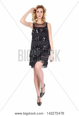 Fashion model wearing black evening gown isolated