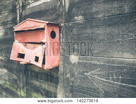Old steel red mailbox hang on the wall, With place your text