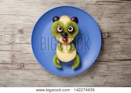 Panda made of fruits on plate and board