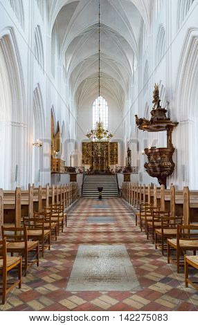 Odense, Denmark - July 21, 2015: The nave of the gothic St. Canute's Cathedral
