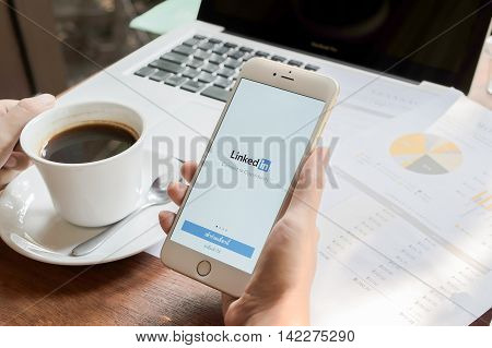 CHIANGMAI THAILAND - MAY 09 2016: White Gold Apple iPhone 6s showing Linkedin screen on man hand holding. iPhone 6s was created and developed by the Apple inc.