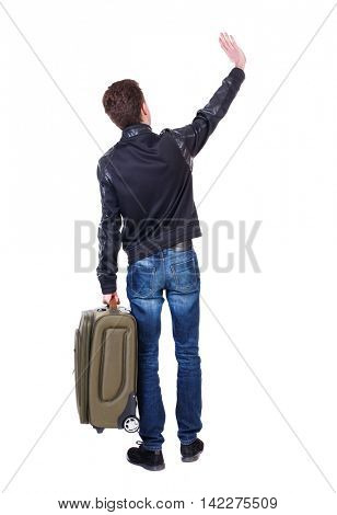 Back view of man with  green suitcase man greeting waving from his hands. Rear view people collection.  backside view of person.  Isolated over white background. The traveler is carrying a suitcase