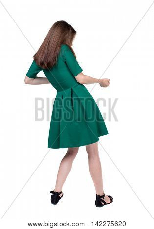 back view of standing girl pulling a rope from the top or cling to something. girl  watching. Rear view people collection.  backside view of person.  Isolated over white background. The slender