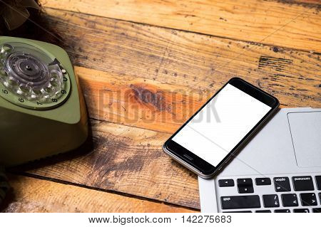 smart phone with blank mobile and cup of coffee .Smart phone with blank screen and can be add your texts or others on smart phone.Smart phone and retro phone concept.