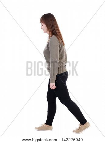 back view of walking  woman. beautiful blonde girl in motion.  backside view of person.  Rear view people collection. Isolated over white background. She goes down to the right hand.