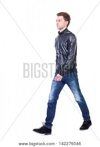Back view of going  handsome man. walking young guy . Rear view people collection.  backside view of person.  Isolated over white background. Curly guy in a black leather jacket comes to meet us.