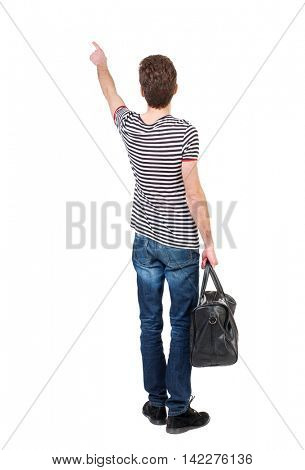 back view of  pointing man  with bag.  backside view of person.  Rear view people collection. Isolated over white background.  Curly boy in a striped vest holding a bag in his hand and shows up finger