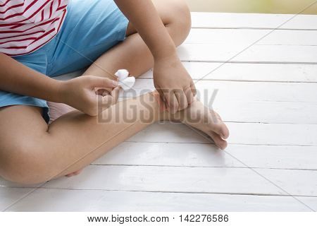 Child wound on leg and druging wounds on wooden white background,Top view and close up