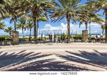 People Enjoy The Hot Summer Day At South Beach In Miami