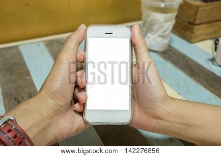 Close up of a man and woman holding smart phone with blank mobile and cup of coffee .Smart phone with blank screen and can be add your texts or others on smart phone.