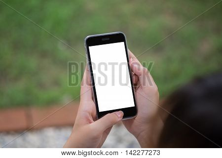 Close up of a woman using smart phone with blank mobile and cup of coffee .Smart phone with blank screen and can be add your texts or others on smart phone.