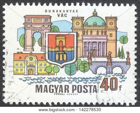 MOSCOW RUSSIA - CIRCA MAY 2016: a post stamp printed in HUNGARY shows coat of arms and buildings of VAC the series