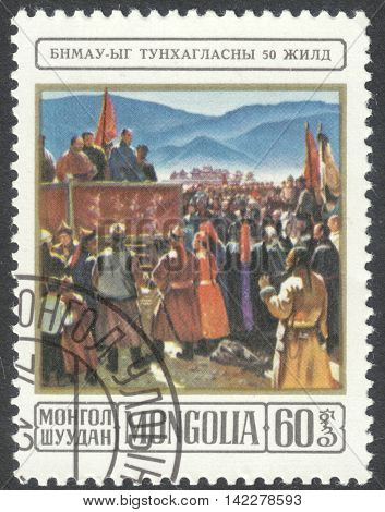 MOSCOW RUSSIA - CIRCA MAY 2016: a post stamp printed in MONGOLIA shows Sukhe Bator proclaiming the Republic the series