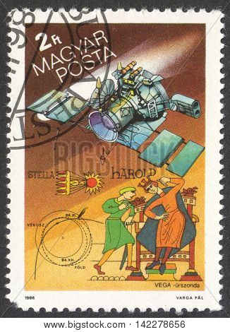 MOSCOW RUSSIA - CIRCA MAY 2016: a post stamp printed in HUNGARY shows a space ship and a comet the series
