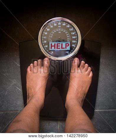 the bathroom scales that speaks to you and tells you the truth by writing it on the screen: help!