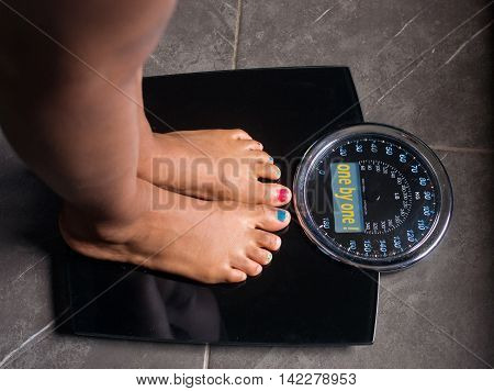 the bathroom scales that speaks to you telling you the truth by writing it on the screen and is also witty: one at a time!