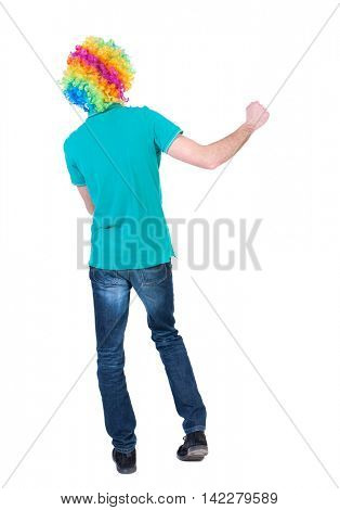 back view of dancing young beautiful  man  in clown wig.  Rear view people collection.  backside view of person.  Isolated over white background. Curly man in a turquoise sweater and clown wig waving
