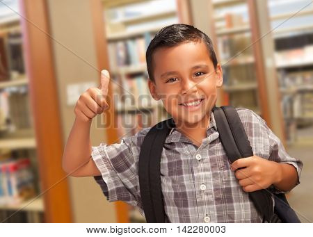 Handsome Hispanic Student Boy with Back Pack and Thumbs Up in the Library.