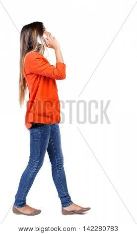 side view of a woman walking with a mobile phone. back view of girl in motion.  backside view of person.  Rear view people collection. Isolated over white background. girl in a red jacket and white is