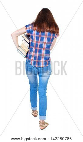 Girl comes with  stack of books. back side view. Rear view people collection.  backside view of person.  Isolated over white background. Girl in plaid shirt holding out arm textbooks.